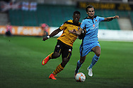 Ryan Jackson of Newport county (l) is challenged by Harrison Dunk of Cambridge.  Skybet football league two match, Newport County v Cambridge Utd at Rodney Parade ,Newport , South Wales on Monday 8th  Sept 2014<br /> pic by Andrew Orchard, Andrew Orchard sports photography.