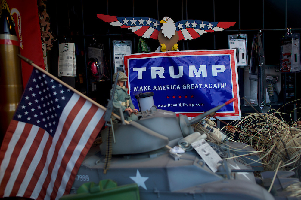 MINERSVILLE, PA - June 6, 2016.   A Donald J. Trump campaign sign is displayed in the storefront of a firearm pawn shop in Minersville, PA on June 6, 2016.  The Republican Presidential hopeful aspires to put the rust belt into play.