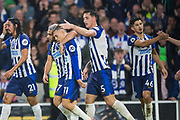 Leondro Trossard (Brighton) celebrates his goal with Neal Maupay (Brighton) & Lewis Dunk (Capt) (Brighton) during the Premier League match between Brighton and Hove Albion and Everton at the American Express Community Stadium, Brighton and Hove, England on 26 October 2019.