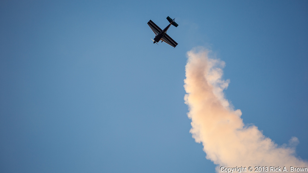 Greg Howard in his Giles 202 flying maneuvers at the Airshow of the Cascades.