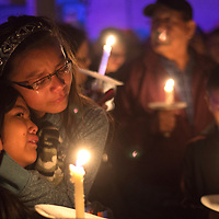 Taytum Largo, right, holds Madison Lee as the girls mourn the death of their uncle Officer Houston Largo during a vigil in his honor at the Gallup Police Department in Gallup Monday March 13. Officer Houston Largo was shot responding to a domestic violence call Sunday.