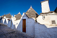 Stone Trulo house with beehive shaped conical roof, traditional Turlli houses of Alberobello, Apulia, Italy .<br /> <br /> Visit our ITALY HISTORIC PLACES PHOTO COLLECTION for more   photos of Italy to download or buy as prints https://funkystock.photoshelter.com/gallery-collection/2b-Pictures-Images-of-Italy-Photos-of-Italian-Historic-Landmark-Sites/C0000qxA2zGFjd_k