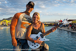 Caleb Koziel with his wife Darci, winner of Jesse James Dupree's guitar give-away at the Harley-Davidson HOG pool party at the Full Throttle Saloon during the Sturgis Motorcycle Rally. SD, USA. Thursday, August 12, 2021. Photography ©2021 Michael Lichter.