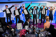 Brendan Cole (c), Stictly Come Dancing  does the Bolt with others in the game of heads and tails- UK charity, Sport for Freedom (SFF), marks Anti-Slavery Day 2015 by hosting a charity Gala Dinner, supported by Aston Martin, on Thursday 15th October at Stamford Bridge, home of Chelsea Football Club. This inaugural event brought together people from the world of sport, entertainment, media, and business to unite behind a promise to tackle the issue of modern day human trafficking and slavery.  <br /> Hosted by Sky presenters Sarah-Jane Mee and Jim White, the Sport for Freedom Gala Dinner includes guests such as jockey AP McCoy OBE; Denise Lewis, former British Olympic Gold Medal winner; BBC Strictly star, Brendan Cole; Al Bangura, former Watford FC player and Sport for Freedom Ambassador who was trafficked from Africa to the UK at the age of just 14yrs old; Made in Chelsea star, Ollie Proudlock; ITV weather presenter, Lucy Verasamy; Sky Sports F1 presenter and SFF Ambassador, Natalie Pinkham; Premier League footballers Ryan Bertrand of Southampton FC and Troy Deeney of Watford FC and champion boxer, Anthony Joshua; and The UK's first independent Anti Slavery Commissioner, Kevin Hyland OBE, who highlighted the issues of modern day slavery that face the UK and world today. <br /> The evening concluded with chart topping music from 'Naughty Boy'. <br /> Sport for Freedom are also joining forces with the Premier League Academies for an international  'Football for Freedom' tournament with their U16's players that will also involve educating those taking part about the issues surrounding modern day slavery. The final will take place at Liverpool FC's Academy on Anti-Slavery Day, 18th October.
