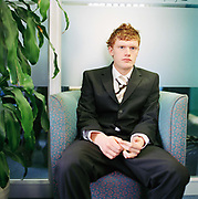 Billy Astel, waiting for an interview for the position of call centre agent at the Listening Company in Richmond. Is it possible to see pre interview nerves by looking at  his body language? Possibly,  these days some interviewers are trained to examine body language as part of their interview technique.From the series Desk Job, a project which explores globalisation through office life around the World.