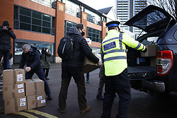 © Licensed to London News Pictures. 02/02/2021. Woking, UK. Boxes of Covid testing kits are distributed from Woking fire station ahead of delivery to households in the Goldsworth Park area of Surrey, where cases of the South African variant of Covid-19 have been found. Public health England are carry out surge testing for selected parts of the Goldsworth Park, St Johns and Knaphill areas of Woking. Photo credit: Peter Macdiarmid/LNP