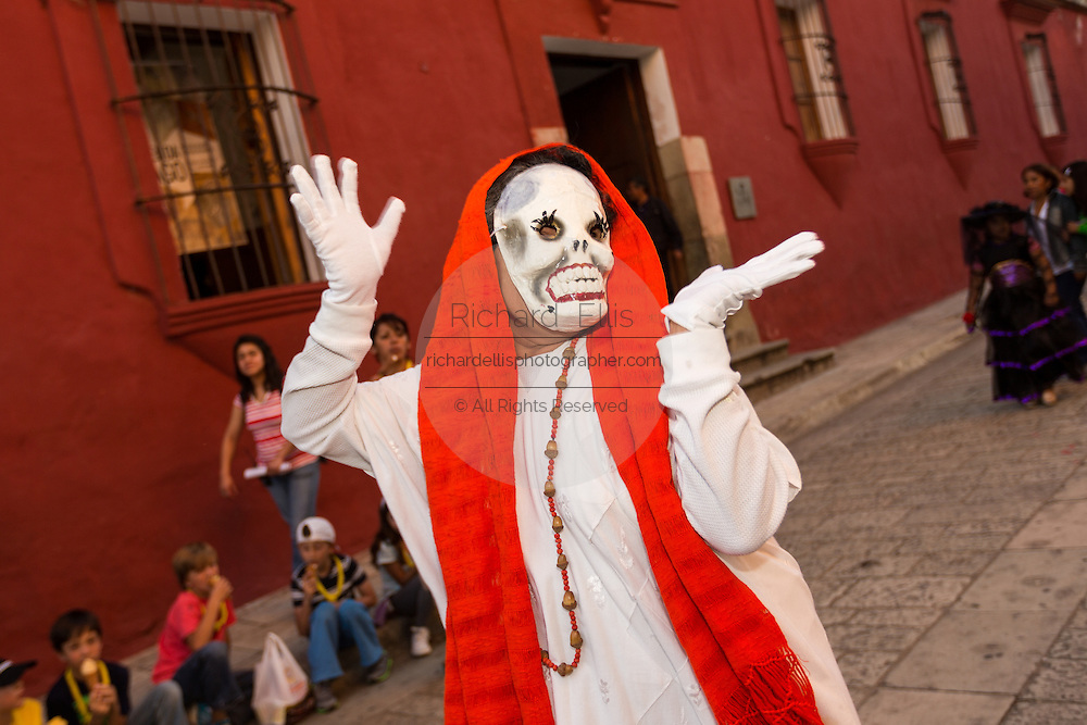 A woman wearing a skeleton costume parades during the Day of the Dead Festival known in spanish as Día de Muertos October 28, 2014 in Oaxaca, Mexico.