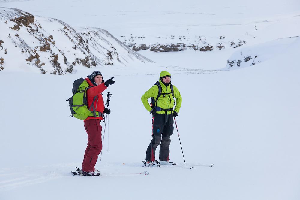 Michelle Blade (left) and Nate Stevens discuss ski objectives in Foxdalen, Svalbard.