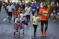 November 13, 2016 - Athens, Attica, Greece - A father runs with his four daughters. Thousands of people from all over the world took part in the 2016 Athens Marathon the Authentic, which starts in the town of Marathon and is ending in Athens, the route, which according to legend was first run by the Greek messenger Pheidippides in 490 BC. (Credit Image: © Michael Debets/Pacific Press via ZUMA Wire)