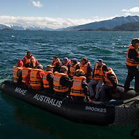 Tourists board a zodiac raft from Chilean cruise ship Mare Australis, en route to Navarino Island in Tierra del Fuego, Chile.