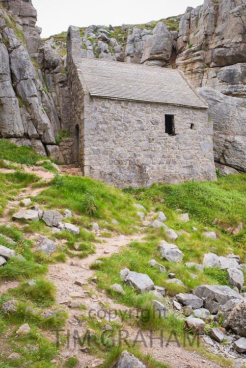 St. Govan's Chapel at St. Govan's Head, Pembrokeshire built of limestone into a limestone cliff, it measures 20 by 12 feet