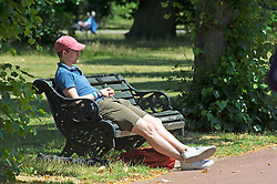 ©Licensed to London News Pictures 22/06/2020<br /> Greenwich, UK. A man relaxing in the sun. A warm sunny day in Greenwich park, Greenwich, London. The UK to enjoy hot heatwave weather this week with temperatures set to bring the hottest day of the year so far. Photo credit: Grant Falvey/LNP