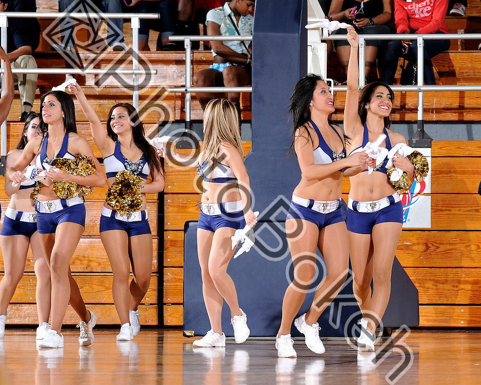 2011 February 19 - Florida International University Golden Dazzlers dance team throw t-shirts to the sidelines. FIU Golden Panthers fell to the Florida Atlantic Owls in overtime, 80-78, at U.S. Century Bank, Miami, Florida