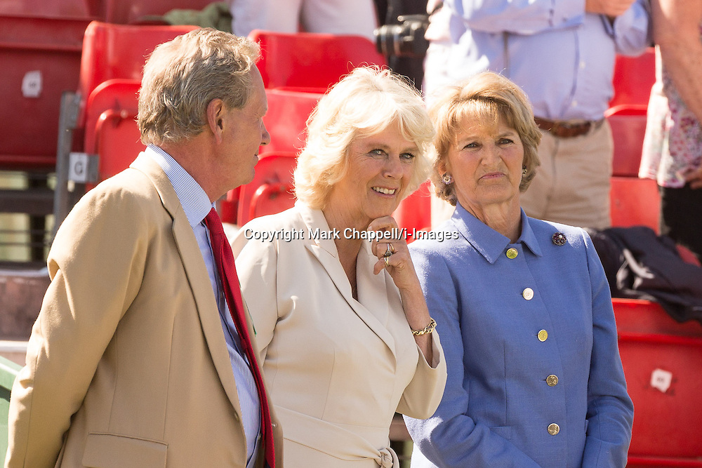 HRH The Duchess of Cornwall and the Duchess of Beaufort share a moment following the presentation of awards at the end of the Mitsubishi Motor Badminton Horse Trials 2013. Also in photo to the Duchess' left is Hugh Thomas, the event's director. Monday 06  May  2013.  Badminton, Gloucs, UK.<br /> Photo by: Mark Chappell/i-Images