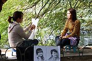 street artist on the banks of the Ngo Dong River, Ninh Binh, Vietnam
