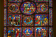 Medieval Windows of the Gothic Cathedral of Chartres, France, dedicated to St Martin of Tour.    A UNESCO World Heritage Site. In the top central oval panel St Martin is ordained Bishop of Tour, box below left Martin is attacked by brigands. .<br /> <br /> Visit our MEDIEVAL ART PHOTO COLLECTIONS for more   photos  to download or buy as prints https://funkystock.photoshelter.com/gallery-collection/Medieval-Middle-Ages-Art-Artefacts-Antiquities-Pictures-Images-of/C0000YpKXiAHnG2k