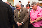 North Charleston Mayor Keith Summey prays with worshippers during a healing service at Charity Missionary Baptist Church April 12, 2015 in North Charleston, South Carolina. Sharpton spoke following the recent fatal shooting of unarmed motorist Walter Scott police and thanked the Mayor and Police Chief for doing the right thing in charging the officer with murder.