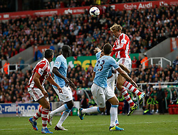 Stoke City's Peter Crouch wins an aerial ball - Photo mandatory by-line: Matt Bunn/JMP - Tel: Mobile: 07966 386802 14/09/2013 - SPORT - FOOTBALL -  Britannia Stadium - Stoke-On-Trent - Stoke City V Manchester City - Barclays Premier League