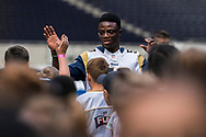 Samson Ebukam (LB, LA Rams) greets the kids ahead of todays NFL Flag National Championship Finals during the NFL UK Media Day at Tottenham Hotspur Stadium, London, United Kingdom on 3 July 2019.