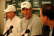 Brett Favre, center is introduced to the media during a press conference with New York Jets owner Woody Johnson and general manager Mike Tannenbaum during a press conferece August 7, 2008 at Cleveland Browns Stadium