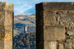 View of Wallace Monument though battlements of Stirling Castle in Stirling, Stirlingshire, Scotland, United Kingdom.