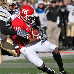 Nov. 22, 2008; Piscataway, NJ, USA; Rutgers wide receiver Kenny Britt (88) makes a catch while being dragged down by Army defensive back Jean Pierre Cooper (27) during the first quarter of Rutgers' 30-3 victory over Army at Rutgers Stadium.
