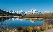Mt Moran (12,605 feet) reflects in the Snake River at Oxbow Bend, in Grand Teton National Park, Wyoming, USA. <br /> The mountain is named forThomas Moran, an American western frontier landscape artist. Mount Moran dominates the northern section of theTeton Rangerising 6000 feet aboveJackson Lake.Several active glaciers exist on the mountain withSkillet Glacierplainly visible on the monolithic east face. This image was stitched from multiple overlapping photos.