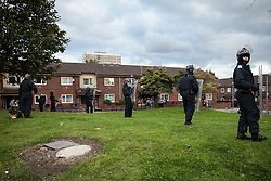 © Licensed to London News Pictures . 09/08/2011 . Salford , UK . Police at Salford Precinct as disorder spreads to Manchester during a 4th night of rioting and looting , following a protest against the police shooting of Mark Duggan in Tottenham . Photo credit : Joel Goodman/LNP