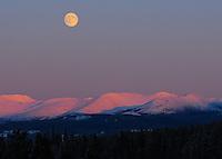Moonrise over mountains near Whitehorse, Yukon
