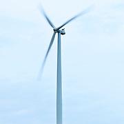 Wind turbine against clear sky