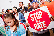 """16 JANUARY 2010 -- PHOENIX, AZ: Some of the crowd of about 10,000 people marched the 2.5 miles from Falcon Park to the """"Tent City"""" on Durango to protest against Maricopa County Sheriff Joe Arpaio and his immigration enforcement tactics. PHOTO BY JACK KURTZ"""