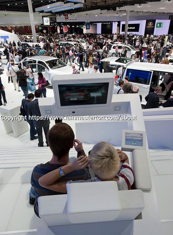 Visitors using 3D television at Paris Motor Show 2010