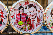 08 MAY 2013 - BANGKOK, THAILAND:  Clocks for sale with photos of Thai Prime Minister Yingluck Shinawatra and former PM Thaksin Shinawatra at a Red Shirt protest. The Shinawatras are supported by the Red Shirts. A splinter group of the Red Shirts, Thai supporters of exiled Prime Minister Thaksin Shinawatra, have besieged the Thai Constitutional Court for the last three weeks calling for the resignation of the justices, who have indicated they might oppose a proposed constitutional reform which would grant amnesty to people convicted of political crimes since 2007. This would probably include Thaksin. The justices have refused to step down. Wednesday the protesters moved their protest to the Thai Parliament, which is largely powerless to intervene.  PHOTO BY JACK KURTZ