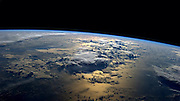 How aliens see us: Planet Earth, as viewed by International Space Station astronauts<br /> <br /> Tweeting from orbit has, it seems, become an important part of any self respecting astronaut's daily routine.<br /> But as these incredible images show, the results really are worth it. <br /> In a trend pioneered by Canadian ISS commander Chris Hadfield, new recruits are now tweeting regularly from orbit.<br /> Astronaut Reid Wiseman, who is currently aboard the station, is a prolific snapper, along with his German colleague Alexander Gerst. <br /> The pair have even developed their own styles, with Gerst preferring abstract patterns on the Earth's surface, while Wiseman favours storms and cities.<br /> Recently Gerst took part in a live Facebook Q&A to answer questions from people on Earth.<br /> One included Sir Richard Branson, who asked: 'What do you think the role of astronauts will be in 50 years' time? Pioneers? Guides? Or the norm?'<br /> Gerst responded: 'My hope would be that in 50 years from now, space travellers will not only be professional agency astronauts, but that everybody should have a realistic chance to make the incredible experience I am having right now.<br /> 'Anyway, I hope there will still be pioneers out there who will fly to destinations farther away.'<br /> <br /> Photo shows: Astronaut Reid Wiseman posted this photo to Twitter on Sept. 2, 2014 from the International Space Station with the caption, 'My favorite views from #space just past #sunrise over the ocean.'<br /> ©Reid Wiseman/Exclusivepix