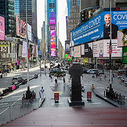 Times Square remains sparse during the Phase 4 reopening on Monday, August 3, 2020 in New York, New York. Mayor de Blasio is asking travelers from 34 states and Puerto Rico, where COVID-19 infection rates are high, to quarantine for 14 days after arriving in the city.  (Alex Menendez via AP)
