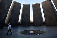 Michael, a Syrian-Armenian from Aleppo, walking inside the Armenian genocide memorial in Yerevan. Michael came to Armenia from Syria in October 2012 and now works as a taxi driver, after a sucessful career in graphic design in Syria.