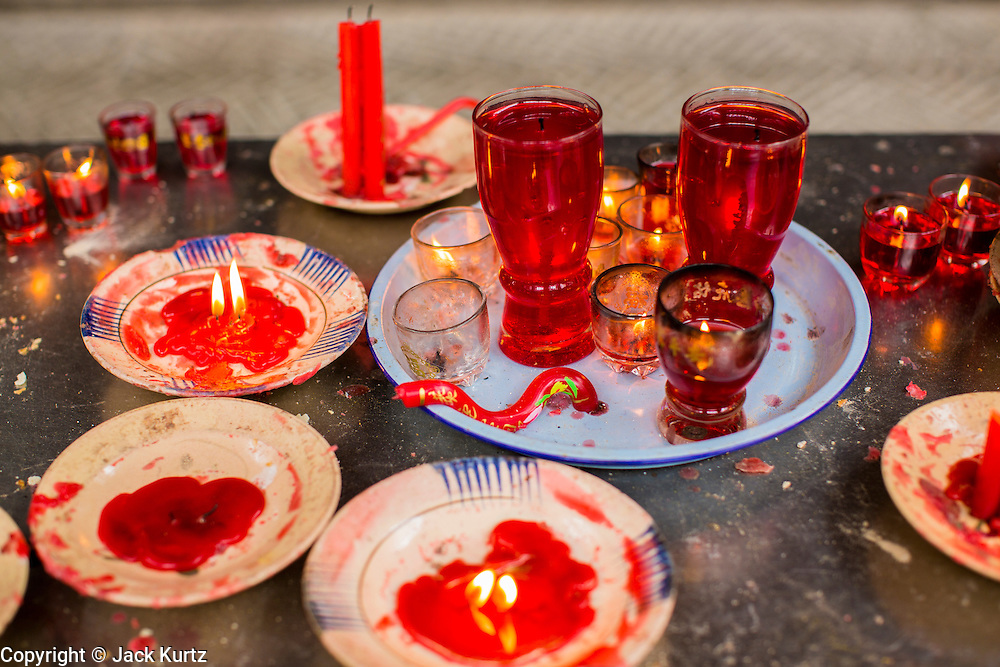 """12 APRIL 2012 - HO CHI MINH CITY, VIETNAM:   Candles left as offerings in Chùa Bà Thiên Hu (The Pagoda of the Lady Thien Hau), a Chinese style temple located on Nguyen Trai Street in Cholon. It is dedicated to Thiên Hu, the Lady of the Sea (""""Tian Hou"""" as transcribed from the Chinese). Cholon is the Chinese-influenced section of Ho Chi Minh City (former Saigon). It is the largest """"Chinatown"""" in Vietnam. Cholon consists of the western half of District 5 as well as several adjoining neighborhoods in District 6. The Vietnamese name Cholon literally means """"big"""" (lon) """"market"""" (cho). Incorporated in 1879 as a city 11km from central Saigon. By the 1930s, it had expanded to the city limit of Saigon. On April 27, 1931, French colonial authorities merged the two cities to form Saigon-Cholon. In 1956, """"Cholon"""" was dropped from the name and the city became known as Saigon. During the Vietnam War (called the American War by the Vietnamese), soldiers and deserters from the United States Army maintained a thriving black market in Cholon, trading in various American and especially U.S Army-issue items.        PHOTO BY JACK KURTZ"""