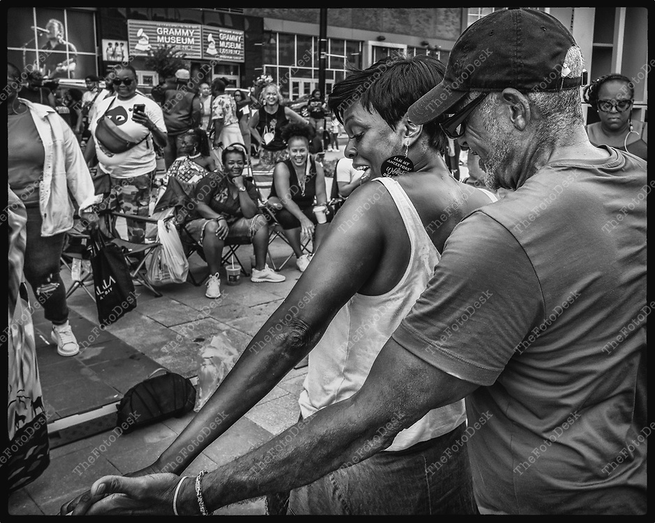 NEWARK, NEW JERSEY: A  couple dances the hustle during the Bang The Drum House Music festival at Mulberry Commons in in Newark, NJ on Sunday, August 29, 2021. (Brian B Price/TheFotodesk).