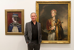 © Licensed to London News Pictures. 15/12/2011. London, UK. Historian and broadcaster, Simon Schama with Vanessa Bell's 'Byzantine Lady' (1912) (left) which belongs in HM Ambassador's Residence in Berlin, and Thomas Phillips' 'George Gordon Noel Byron, 6th Baron Byron' (1814) (right) which belongs in HM Ambassador's Residence in Athens seen at the Government Art Collection: Selected by Simon Schama: Travelling Light at the Whitechapel Gallery. Photo credit : James Gourley/LNP