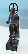Standing Buddha, Indonesia, South Sumatra, c. 600-750.  bronze. This kind of Buddha figurine is based on Indian models and was widely distributed in Southeast Asia, from Thailand to Indonesia.  With his right hand, the Buddha is making the vitarka mudra, the gesture of teaching.  The halo behind his head may be a later addition