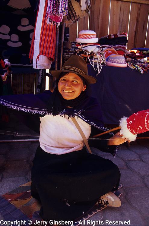 Indigenous peoples selling native wares in the open market of Salasaca, Ecuador.