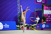 Griskenas Evita during final of ribbon at the World Cup Pesaro, Adriatic Arena on April 15, 2018. Evita is a promising young American athlete born in Chicago in 2000.Today is Senior Member of United States National Team.