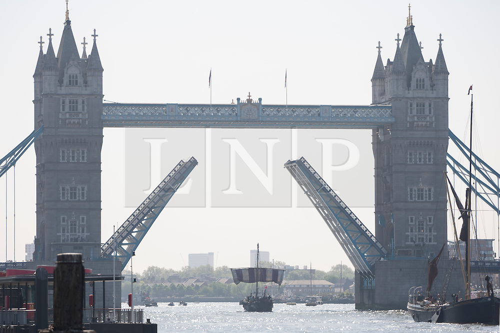 © licensed to London News Pictures. London, UK 30/05/2012. Replica of Phoenicia ship from 600 BC sails under Tower Bridge as it sails into London this morning, 2,500 years after the original expedition to circumnavigate Africa. Photo credit: Tolga Akmen/LNP