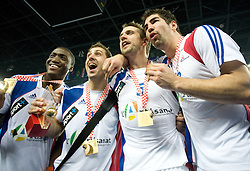 Luc Abalo (19), Michael Guigou (21), Guillaume Gille (5) and Nikola Karabatic (13) of France celebrate after the 21st Men's World Handball Championship 2009 Gold medal match between National teams of France and Croatia, on February 1, 2009, in Arena Zagreb, Zagreb, Croatia. France won 24:19 and became World Champion 2009.  (Photo by Vid Ponikvar / Sportida)