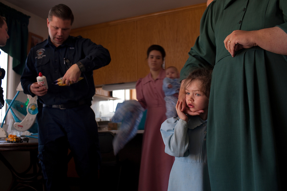 An FLDS paramedic comes to the aid of Nancy Keate, 26, who had chest pain from ingesting grapefruit seed extract, Hildale, Utah, Feb. 26, 2009. Known for their practice of polygamy, the Fundamentalist Church of Jesus Christ of Latter-Day Saints, FLDS, is the United States' largest practitioner of plural marriage. The FLDS church emerged in the early 1900's when its founding members left mainstream Mormon church, largely due to the issue of plural marriage. They gained international notoriety with the arrest of their leader Warren S. Jeffs, who in May 2006 was placed on the FBI's Ten Most Wanted List for unlawful flight to avoid prosecution on Utah state charges related to his alleged arrangement of unlawful marriages between his adult male followers and underage girls. In April 2008, Texas Rangers raided their ranch in Eldorado, Texas after receiving over what was later determined to be a hoax call, although authorities eventually removed 440 children from the ranch, which they said had been sexually, physically and emotionally abused. The children are now back at home.