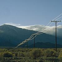 Sunset over power lines in the desert.