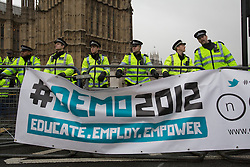© licensed to London News Pictures. London, UK 21/11/2012. Police officers blocking the road to Parliament Square as students and members of the NUS (National Union of Students) march through central London to protest against government cuts to further and higher education, on November 21, 2012. Photo credit: Tolga Akmen/LNP