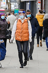 © Licensed to London News Pictures. 10/11/2020. London, UK. Shoppers with face coverings in north London as the national lockdown continues. The national lockdown in England until Wednesday 2 December, is in place to control the spread of COVID-19 cases. Photo credit: Dinendra Haria/LNP