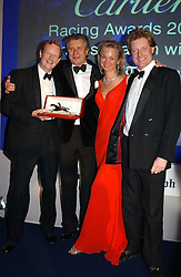 Left to right, The EARL OF DERBY, MR ARNAUD BAMBERGER, the COUNTESS OF DERBY and the HON.PETER STANLEY at the 2004 Cartier Racing Awards in association with the Daily Telegraph, held at the Four Seasons Hotel, London on 17th November 2004.<br />