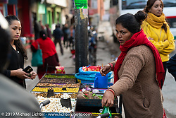 Vendors sell their wares to passengers in the Bhaktapur Bus Depot in Kathmandu. Thursday, November 14, 2019. Photography ©2019 Michael Lichter.